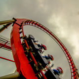 Crazy rollercoaster rides at amusement park Stock Photography