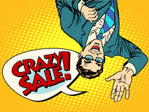 Crazy sale announcement man upside down Royalty Free Stock Photo