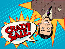Crazy sale announcement man upside down Royalty Free Stock Photos