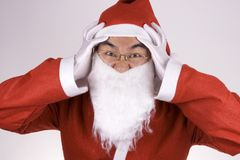 Crazy Santa Claus. An Asian santa claus with crazy expression Royalty Free Stock Photo