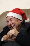 Crazy santa claus. Crazy old senior man acting santa claus stock image