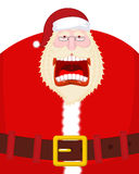 Crazy Santa Shout and belt. Scary grandfather yelling. Open mout Stock Photo