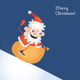 Crazy Santa sledding down a snowy hill astride his sack. Christmas card. Stock Images