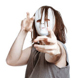 Crazy scary masked man. Insane scary masked man gesturing, isolated on white background Stock Photography