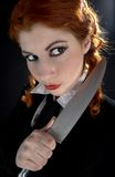 Crazy schoolgirl with knife Stock Image