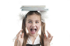 Crazy schoolgirl  with textbooks on her head. Stock Image
