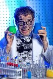 Crazy scientist. Medical theme: funny crazy scientist is working in a laboratory Royalty Free Stock Image