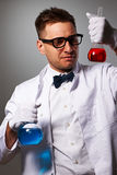 Crazy scientist. Against grey background Royalty Free Stock Photography