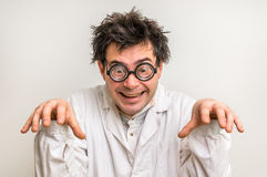 Crazy scientist with glasses and white coat Royalty Free Stock Image