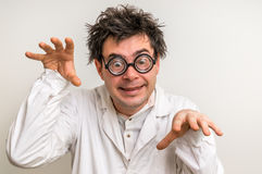 Crazy scientist with glasses and white coat Royalty Free Stock Photos