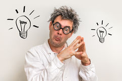 Crazy scientist got the great idea with bulb symbol Royalty Free Stock Images