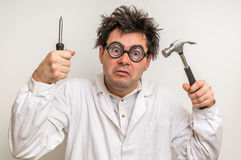 Crazy scientist with hammer and screwdriver Royalty Free Stock Photography