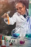 Crazy scientist at laboratory stock image