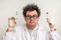 Crazy scientist performing experiments in laboratory Royalty Free Stock Image