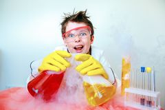 Crazy scientist performing experiments Royalty Free Stock Image