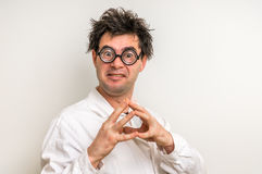 Crazy scientist thinking about his experiment Royalty Free Stock Photography