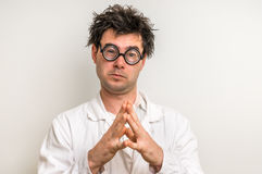 Crazy scientist thinking about his experiment. Crazy scientist with glasses thinking about his experiment Royalty Free Stock Photos