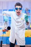 Crazy scientist with wind machine stock images