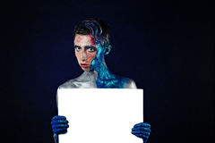 Crazy Screaming androgyne man with face art with POSTER. Blank f Royalty Free Stock Photography