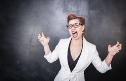 Crazy screaming teacher on chalkboard background. Crazy screaming teacher on chalkboard blackboard background stock image