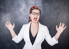 Crazy screaming teacher. On chalkboard blackboard background stock photo