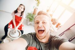 Crazy selfie photo of pair of friends pottery master class on a potter wheel man and girl. Crazy selfie photo of pair of friends pottery master class on a potter stock images