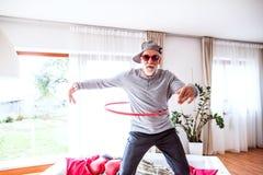 Senior man having fun at home. Crazy senior man having fun at home royalty free stock images