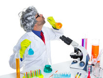 Crazy silly nerd scientist drinking chemical experiment Stock Photo