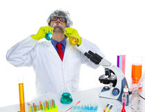 Crazy silly nerd scientist drinking chemical experiment Stock Images