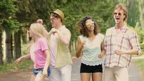 Crazy smiling couples dancing and hanging out at open-air music festival, summer. Stock footage stock footage