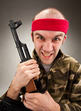 Crazy soldier with machine gun. Portrait of crazy soldier with machine gun stock image