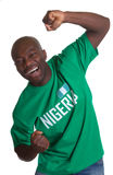 Crazy sports fan from Nigeria. Is happy about his national team on an isolated white background stock images