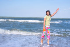 Crazy sporty woman is expressively laughing on the beach Royalty Free Stock Photo