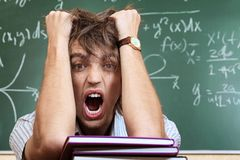 Crazy student. Educational theme: crazy male student in a classroom Royalty Free Stock Photos