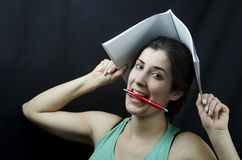 The crazy student. Girl who goes crazy with pen, conceptual Stock Photo