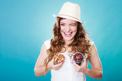 Crazy summer woman holds cakes in hands Royalty Free Stock Photo