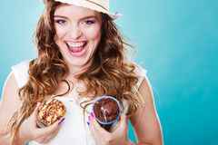 Crazy summer woman holds cakes in hands Stock Photo