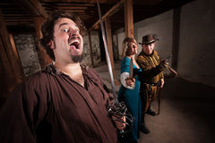 Crazy Swashbucklers with Weapons Stock Photography