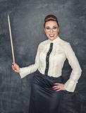 Crazy teacher with wooden pointer Royalty Free Stock Photography