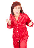 Crazy teenage girl in red pyjamas Stock Images