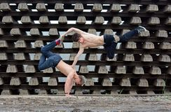 Crazy teenagers dancing break dance on the rails Stock Photos