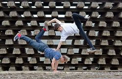 Crazy teenagers dancing break dance on the rails Royalty Free Stock Photography
