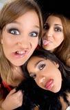 Crazy teens. Three teenage girls making bizarre faces Stock Photos