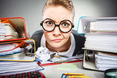 Crazy thoughtful accountant businesswoman. Facial expressions during work. Crazy thoughtful accountant businesswoman surrounded by documents and binders in Stock Image
