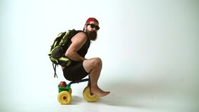 Crazy tourist, happy bicycle rider. A funny bearded man is riding a childrens bicycle. Delivery service.