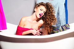 Crazy udressed girl in bathroom Stock Photo