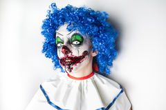 Crazy ugly grunge evil clown. Scary professional Halloween masks. Halloween party Stock Image