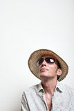 Crazy vacationer in straw hat and sunglasses dreaming. Copy space top. Vertical Royalty Free Stock Photos