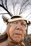 Crazy Viking Lady. Crazy old woman wearing a Viking helmet stock photos