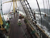 Wild weather at sea on a traditional tallship or sailing vessel Royalty Free Stock Image